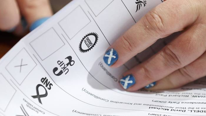 An electoral worker with a Scottish Saltire painted on her finger nails counts ballots after polls closed in Britain's general election at a counting centre in Aberdeen, Scotland...An electoral worker with a Scottish Saltire painted on her finger nails counts ballots after polls closed in Britain's general election at a counting centre in Aberdeen, Scotland, May 7, 2015. REUTERS/Cathal McNaughton