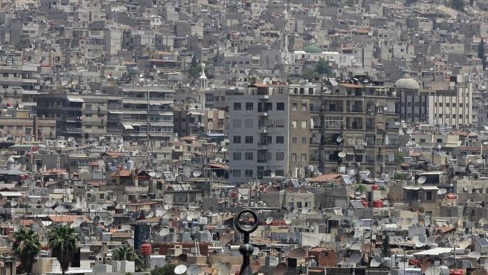 The dome of a mosque is seen amongst satellite dishes on the rooftops of home and apartment blocks in the Syrian capital Damascus, on June 26, 2013. AFP PHOTO / LOUAI BESHARA (Photo credit should read LOUAI BESHARA/AFP/Getty Images)