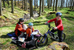 A family on a cycling trip in Scotland