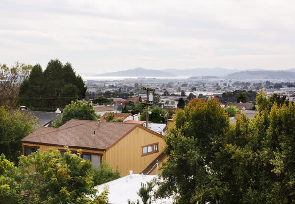 The house has views through the trees of San Francisco Bay