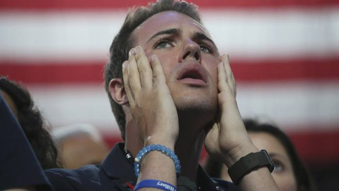 QUALITY REPEAT - A supporter of Democratic U.S. presidential nominee Hillary Clinton reacts at the election night rally the Jacob K. Javits Convention Center in New York, U.S., November 8, 2016. REUTERS/Adrees Latif