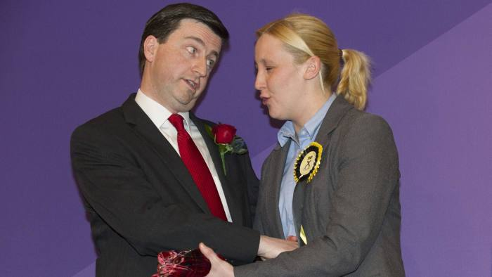 Newly elected Scottish National Party (S...Newly elected Scottish National Party (SNP) member of parliament, Mhairi Black (R), Britain's youngest member of parliament since 1667, greets Labour candidate Douglas Alexander (L) during the declaration of the general election results for the constituency of Paisley and Renfrewshire South at the Lagoon Leisure Centre, in Paisley, west of Glasgow, Scotland on May 8, 2015. At the age of just 20, Mhairi Black has become Britain's youngest member of parliament since 1667 in a victory which symbolises an expected nationalist landslide in Scotland. Black won a majority of over 5,000 in the election to topple Douglas Alexander, the Labour party's 47-year-old foreign affairs spokesman and campaign chief. AFP PHOTO / LESLEY MARTINLESLEY MARTIN/AFP/Getty Images