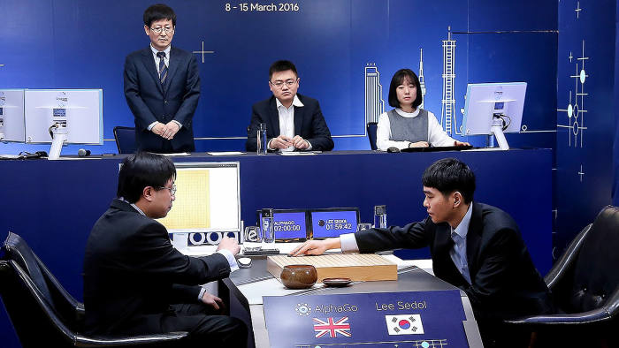 SEOUL, SOUTH KOREA - MARCH 09: In this handout image provided by Google, South Korean professional Go player Lee Se-Dol (R) puts the first stone against Google's artificial intelligence program, AlphaGo, during the Google DeepMind Challenge Match on March 9, 2016 in Seoul, South Korea. Lee Se-dol played a five-game match against a computer program developed by a Google, AlphaGo. (Photo by Google via Getty Images)