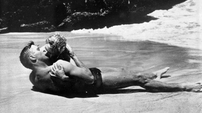 "**FILE**Burt Lancaster kisses Deborah Kerr passionately in a beach scene int he 1953 film ""From Here To Eternity."" Kerr, who shared one of cinema's most famous kisses, has died in Suffolk, eastern England, her agent said Thursday, Oct. 18, 2007. She was 86.(AP Photo/Columbia Pictures)"