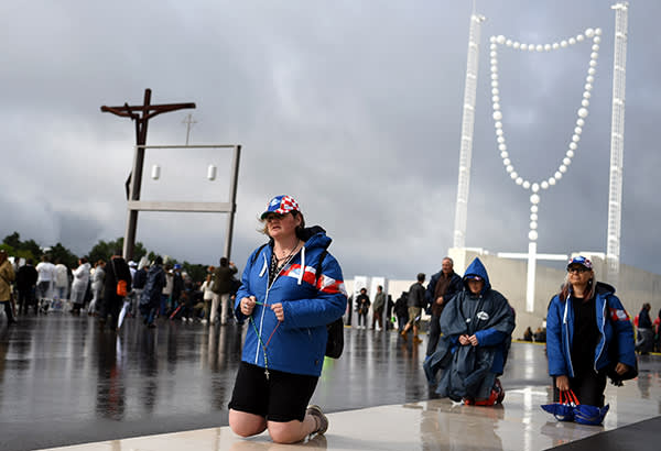 Pilgrims walk on their knees at Fatima Sanctuary, central Portugal, on May 12, 2017. Two of the three child shepherds who reported apparitions of the Virgin Mary in Fatima, Portugal, one century ago, will be declared saints on May 13, 2017 by Pope Francis. The canonisation of Jacinta and Francisco Marto will take place during the Argentinian pontiff's visit to a Catholic shrine visited by millions of pilgrims every year. / AFP PHOTO / Francisco LEONGFRANCISCO LEONG/AFP/Getty Images
