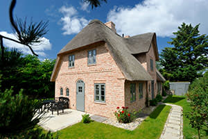 Four-bedroom, thatched house