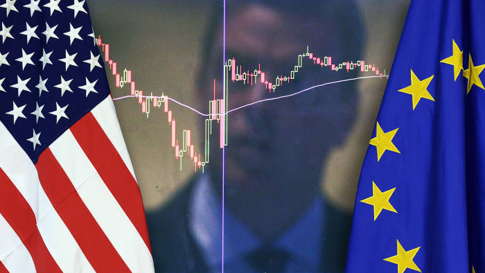 The US national flag (L) and the flag of the European Union are placed side-by-side during the Transatlantic Trade and Investment Partnership (TTIP) meeting at the European Union Commission headquarter in Brussels, on July 13, 2015.