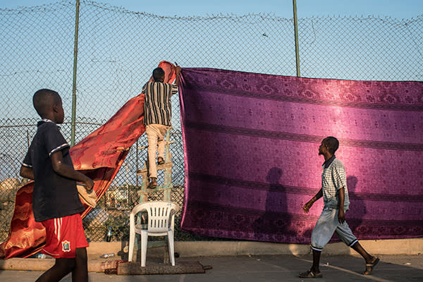 Pro-government campaigners prepare for a rally in support of President Guelleh