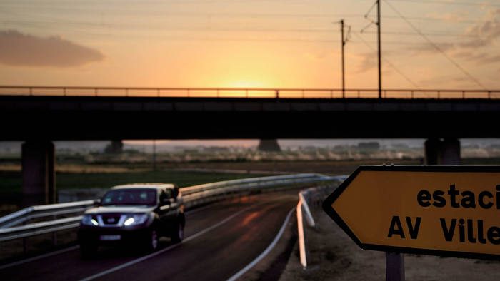 A car crosses the one-lane road which communicates the Villena AVE station with A-31, the Alicante-Madrid highway, in Villena, Spain