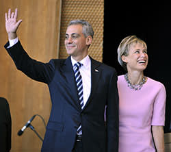 Rahm Emanuel (L) and his wife Amy Rule waves as he is introduced at an inaugural ceremony before being sworn in as mayor of Chicago at Millennium Park on May 16 2011