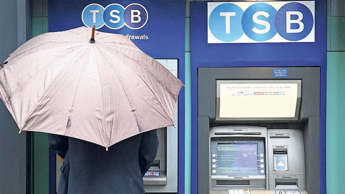 Man withdrawing money from a TSB atm