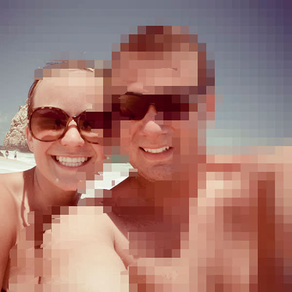 A couple take a self portrait while at the beach in Mexico