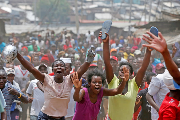 Supporters of an opposition leader Raila Odinga celebrate in Mathare slum after President Uhuru Kenyatta's election win was declared invalid by a court in Nairobi, Kenya, September 1, 2017. REUTERS/Siegfried Modola TPX IMAGES OF THE DAY
