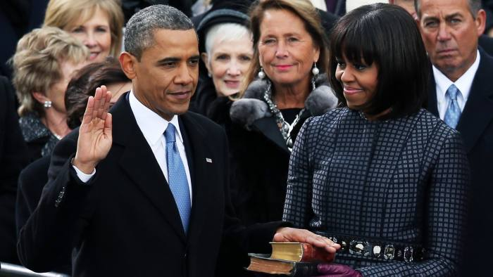 WASHINGTON, DC - JANUARY 21: U.S. President Barack Obama is sworn in during the public ceremony as First lady Michelle Obama looks on during the presidential inauguration on the West Front of the U.S. Capitol January 21, 2013 in Washington, DC. Barack Obama was re-elected for a second term as President of the United States. (Photo by Alex Wong/Getty Images)