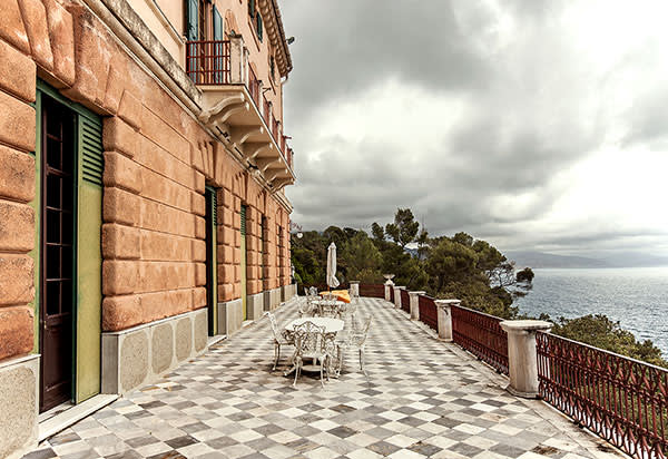 The chequered-floor terrace looks out over the Ligurian Sea
