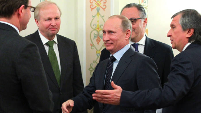 Bob Dudley, chief executive of British energy giant BP (2nd L) , looks on as Russia's Prime Minister Vladimir Putin (C) shaking hands during a meeting in Putin's Novo-Ogaryovo residence outside Moscow, on March 21, 2013, with Russia's state oil giant Rosneft CEO Igor Sechin (R) attending.. Russia's state oil giant Rosneft announced today the creation of the world's largest listed oil company as it completed a $56-billion acquisition of the British and Russian stakes in the joint venture TNK-BP. AFP PHOTO/ RIA-NOVOSTI POOL / MIKHAIL KLIMENTYEV (Photo credit should read MIKHAIL KLIMENTYEV/AFP/Getty Images)