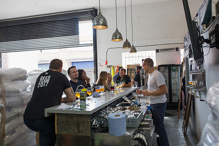 Sampling the beer on a Fourpure brewery tour