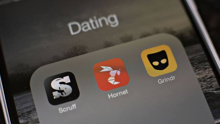 Gay dating apps Scruff, Hornet, and Grindr are displayed for a photograph on an Apple Inc. iPhone in Tiskilwa, Illinois, U.S., on Tuesday, Jan. 20, 2015. For gay men flocking to smartphone dating applications, making a connection increasingly comes with messages about HIV status, testing and drug regimens. Some apps let users declare their status, remind them to get tested and give locations of the closest clinics. Photographer: Daniel Acker/Bloomberg