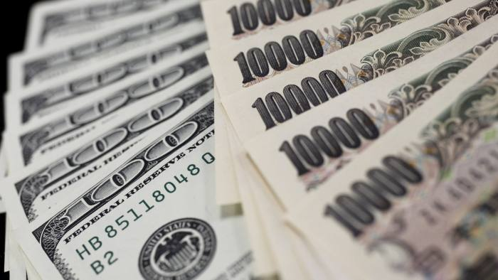 A file picture illustration shows U.S. 100 dollar bank notes and Japanese 10,000 yen notes taken in Tokyo August 2, 2011. The Federal Reserve is widely expected to hike interest rates for the first time in almost a decade on Wednesday. REUTERS/Yuriko Nakao/Files FROM THE FILES - BRACING FOR A FED RATE HIKESEARCH