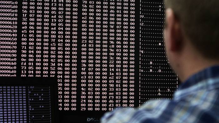 An analyst looks at code in the malware lab of a cyber security defense lab at the Idaho National Laboratory in Idaho Falls, Idaho September 29, 2011. REUTERS/Jim Urquhart (UNITED STATES - Tags: BUSINESS LOGO CRIME LAW MILITARY POLITICS SCIENCE TECHNOLOGY) - RTR2S0ON