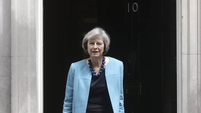 Theresa May, U.K. home secretary, leaves a cabinet meeting in 10 Downing Street in London, U.K., on Monday, June 27, 2016. Leaders of Britain's splintered government sought to reassure investors they'll be able to navigate the fallout from the stunning vote to quit the European Union as the pound extended its drop and international policy makers scrambled to respond. Photographer: Simon Dawson/Bloomberg