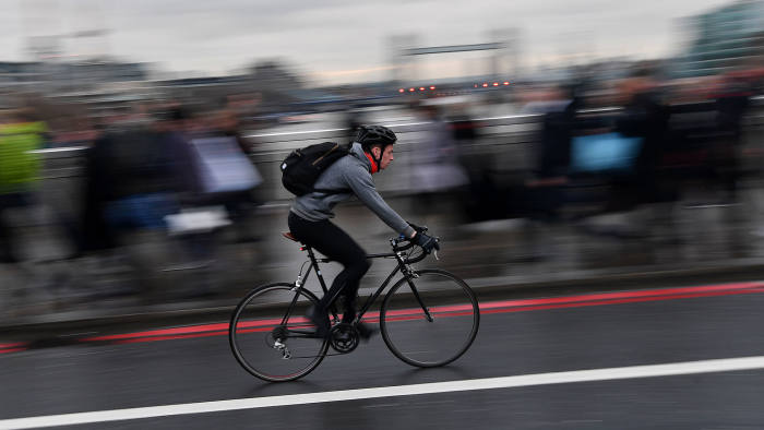 A commuter cycles over London Bridge in London on January 9, 2017 during a 24-hour tube strike.