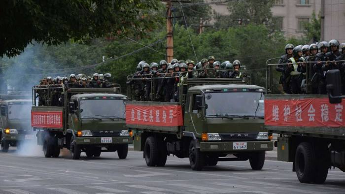 Chinese paramilitary police ride in truc...Chinese paramilitary police ride in trucks during a 'show of force' ceremony in Urumqi after a series of terrorist attacks recently hit Xinjiang Province, on June 29, 2013. Armoured vehicles, personnel carriers and other support vehicles blocked access to streets in Xinjiang's capital Urumqi, where paramilitary units carried out an exercise. The exercises come ahead of the fourth anniversary on July 5 of riots, between members of China's mostly Muslim Uighur ethnic minority and the Han majority group, which left around 200 dead. AFP PHOTO/Mark RALSTONMARK RALSTON/AFP/Getty Images