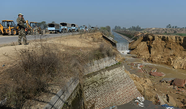 Indian security forces secure the damaged portion of the Munak canal, which supplies water to New Delhi, near Bindroli village in Haryana's Sonipat district, on February 22, 2016. Indian troops won back control of a canal that supplies much of Delhi's water on February 22, as leaders of caste-based protests that have killed at least 19 people accepted an offer aimed at ending the unrest. AFP PHOTO / SAJJAD HUSSAIN / AFP / SAJJAD HUSSAIN (Photo credit should read SAJJAD HUSSAIN/AFP/Getty Images)