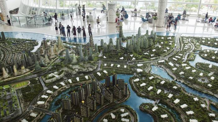 A model of the Forest City development is displayed at the Country Garden Holdings Co. property showroom in Iskandar Malaysia zone of Johor Bahru, Johor, Malaysia, on Tuesday, Nov. 02, 2016. While Chinese home buyers have sent prices soaring from Vancouver to Sydney, in this corner of Southeast Asia it's China's developers that are swamping the market, pushing prices lower with a glut of hundreds of thousands of new homes. They're betting that the city of Johor Bahru, bordering Singapore, will eventually become the next Shenzhen. Photographer: Ore Huiying/Bloomberg
