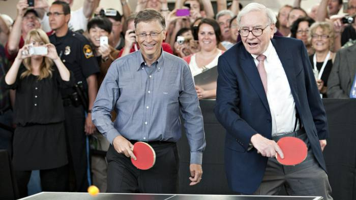 Warren Buffett, chairman of Berkshire Hathaway Inc., right, and Bill Gates, chairman of Microsoft Corp., play table tennis during an event at the annual shareholders meeting in Omaha, Nebraska, U.S., on Sunday, May 6, 2012. Berkshire Hathaway Inc. investment managers Todd Combs and Ted Weschler receive $1 million salaries and can earn more if their bets beat the Standard & Poor's 500 Index, Buffett said Sunday. Photographer: Daniel Acker/Bloomberg *** Local Caption *** Warren Buffett; Bill Gates