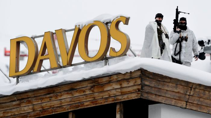 "Swiss special police forces take position next to a sign reading Davos at the opening of the World Economic Forum (WEF) annual meeting in Davos on January 19, 2016. More than 40 heads of states and governments will attend the WEF in Davos, which this year is focused on ""mastering the fourth Industrial Revolution,"" organisers said. / AFP / FABRICE COFFRINI (Photo credit should read FABRICE COFFRINI/AFP/Getty Images)"