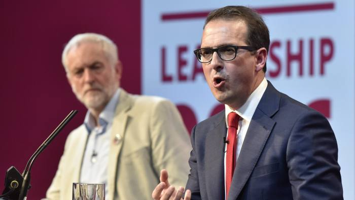 epa05455289 Britain's Labour party leadership candidate Owen Smith (R) and Labour leader Jeremy Corbyn (L) answer questions from the public as part of a debate, at the First Labour leadership debate at the All Nations centre in Cardiff, Wales, Britain, 04 August 2016. EPA/NEIL MUNNS