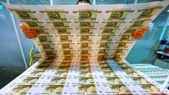 18 Dec 2014, Perm, Russia --- PERM, RUSSIA. DECEMBER 4, 2014. Uncut sheets of 100 ruble banknotes at Perm Printing Factory. Vladimir Smirnov/TASS --- Image by © Smirnov Vladimir/ITAR-TASS Photo/Corbis