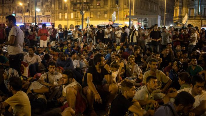 BUDAPEST, HUNGARY - SEPTEMBER 01: Migrants gather in front of Keleti station in central Budapest on September 1, 2015 in Budapest, Hungary. The station was closed today and was said to be an attempt by the Hungarian government to uphold EU law and restore order after recent choatic scenes at the station. According to the Hungarian authorities a record number of migrants from many parts of the Middle East, Africa and Asia crossed the border from Serbia earlier this week, said to be due in part to the erection of a new fence that is due to be completed at the end of this month. Since the beginning of 2015 the number of migrants using the so-called Balkans route has exploded with migrants arriving in Greece from Turkey and then travelling on through Macedonia and Serbia before entering the EU via Hungary. The massive increase, said to be the largest migration of people since World War II, led Hungarian Prime Minister Victor Orban to order Hungary's army to build a steel and barbed wire security barrier along its entire border with Serbia, after more than 100,000 asylum seekers from a variety of countries and war zones entered the country so far this year. (Photo by Matt Cardy/Getty Images)