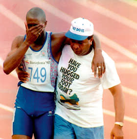Derek Redmond is helped off the track by his father