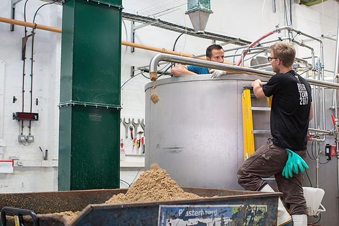 Graining out (removing spent grain from the mash tun) at Fourpure