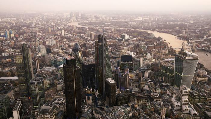 "Aerials Views Of The Canary Wharf Business District And The City Of London...Skyscrapers including Tower 42, the Heron Tower, the Leadenhall building, also known as the ""Cheesegrater,"" 30 St Mary Axe, also known as ""the Gherkin,"" and 20 Fenchurch Street, also known as the ""Walkie-Talkie,"" stand surrounded by commercial office buildings in this aerial photograph looking east along the River Thames towards Canary Wharf from the City of London, U.K., on Monday, Dec. 9, 2013. Bank of England Governor Mark Carney said Britain's recovery will need to be sustained for a while before it is strong enough to withstand higher interest rates. Photographer: Matthew Lloyd/Bloomberg"