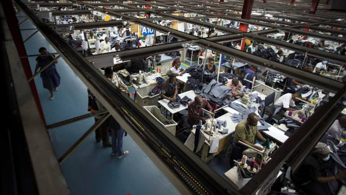 Employees work on the manufacturing line at the United Aryan Export Processing Zone textile factory in Nairobi, Kenya April 13, 2017. Picture taken April 13, 2017. REUTERS/Baz Ratner - RC1BC0D3DFD0
