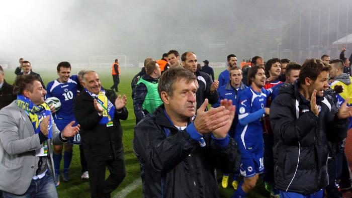 Bosnia and Herzegovina's coach Safet Susic (centre) celebrates his team's 1-0 victory over Lithuania in their World Cup qualifier in Kaunas, October 2013