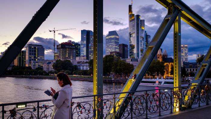FRANKFURT AM MAIN, GERMANY - OCTOBER 05: A woman stands at the bridge 'Eiserner Steg' with skyline and the financial district with the corporate headquarters of Commerzbank on October 5, 2016 in Frankfurt, Germany. Banks across Europe are struggling as their profits have fallen amid an ongoing period of low interest rates, and many, including Commerzbank and Deutsche Bank of Germany, ING and ABN Amro of Holland, and Banco Popular of Spain, are responding by slashing thousands of jobs in an effort to cut costs. (Photo by Thomas Lohnes/Getty Images)
