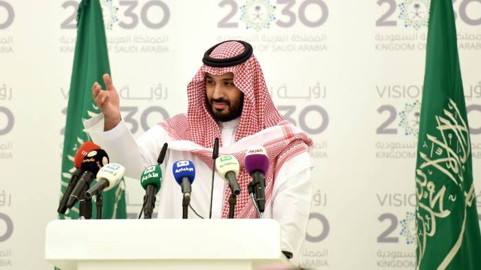 "Saudi Defense Minister and Deputy Crown Prince Mohammed bin Salman gestures during a press conference in Riyadh, on April 25, 2016. The key figure behind the unveiling of a vast plan to restructure the kingdom's oil-dependent economy, the son of King Salman has risen to among Saudi Arabia's most influential figures since being named second-in-line to the throne in 2015. Salman announced his economic plan reform best known as ""Vision 2030"". / AFP / FAYEZ NURELDINE (Photo credit should read FAYEZ NURELDINE/AFP/Getty Images)"