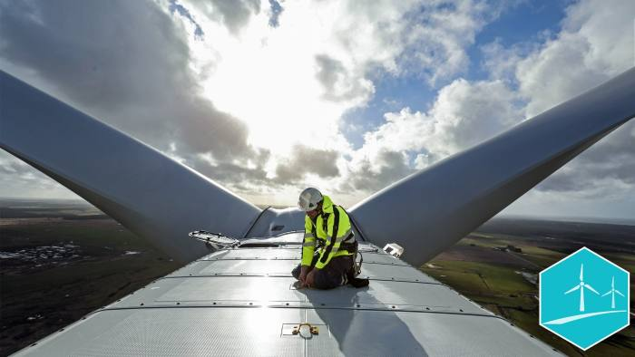 An employee checks a cable on the nacelle of a Vestas A/S V136 wind turbine during operational testing at the Danish National Test Center for Large Wind Turbines in Osterild, Denmark, on Monday, April 18, 2016.