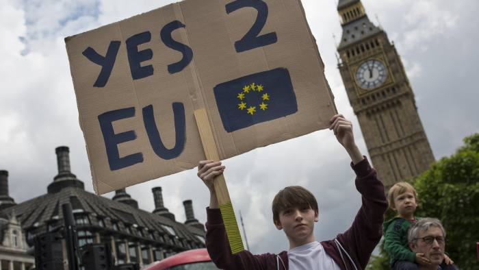 LONDON, ENGLAND - JUNE 25: A small group of young people gather to protest on Parliament Square the day after a majority of the British public voted for leaving the European Union on June 25, 2016 in London, England. The ramifications of the historic referendum yesterday that saw the United Kingdom vote to Leave the European Union are still being fully understood. The Labour leader, Jeremy Corbyn, who is under pressure from within his party to resign has blamed the 'Brexit' vote on 'powerlessness', 'austerity' and peoples fears over the issue of immigration. (Photo by Dan Kitwood/Getty Images)