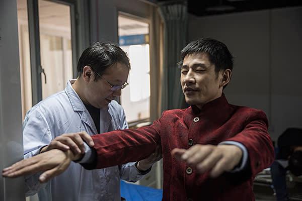 Surgeon Sailike Duishanbai checks the progress of patient Tang Zhu