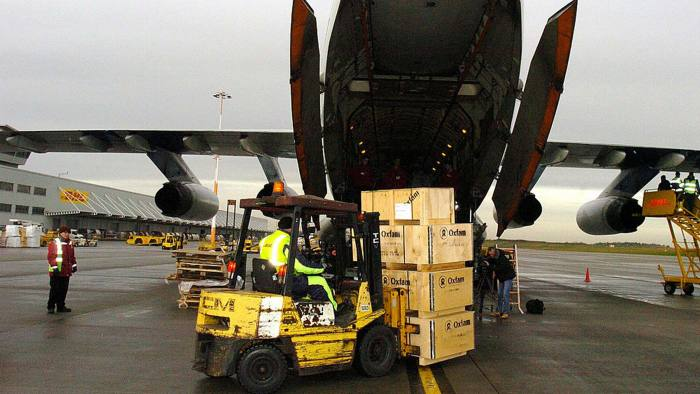 Cargo plane being loaded/unloaded at a UK airport