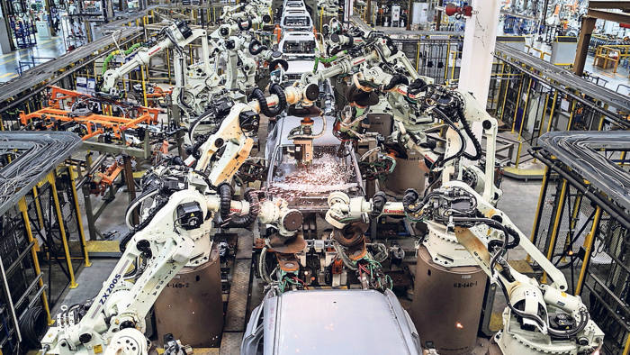 Welding machines assemble cars cockpits at the body shop station along the production line of Ford Focus at the company factory, at the Hemmaraj Eastern Seabord Industrial estate, in Pluak Daeng district, Rayong province, Thailand, on Tuesday, January 28, 2014