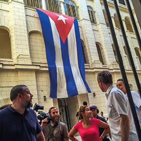 Vice CEO Shane Smith (left) with Vice's photography director Jake Burghart (with camera) and director Spike Jonze (second from right) outside the Museum of the Revolution, Havana