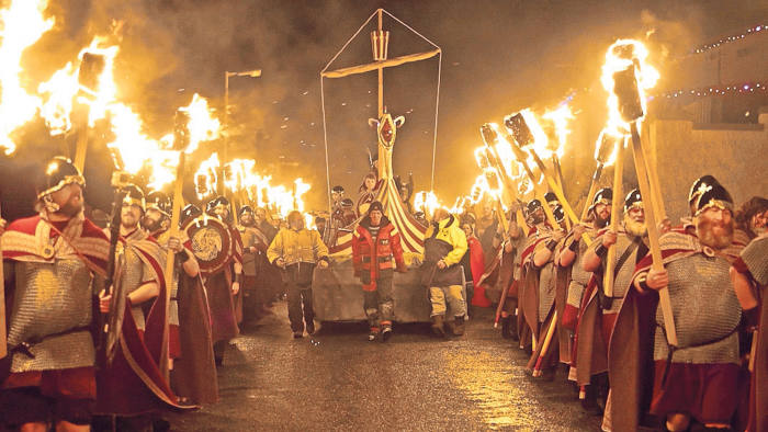 The Scalloway Fire Festival where locals process through the town and set fire to a longship