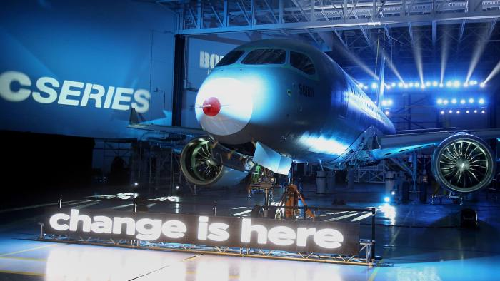 The Bombardier CSeries 100 test airplane is displayed after it was unveiled at the Bombardier production facility in Mirabel, Quebec, Canada, on Thursday, March 7, 2013. Photographer: Patrick Doyle/Bloomberg News.