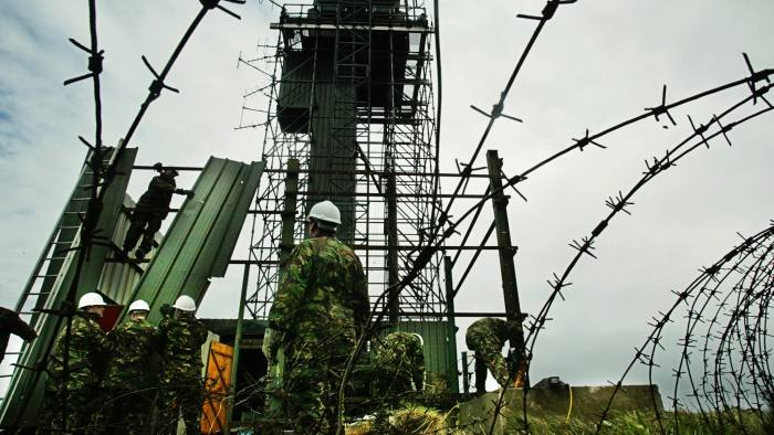 British army sappers carry out demolition work on the Romeo 14 observation post on Cloghoge Mountain, 1.5km south of Newry, South Armagh, Northern Ireland, May 9, 2003. The post over looks the main Belfast to Dublin road close to the border. REUTERS/Paul McErlane PM/MD - RTRN8LS